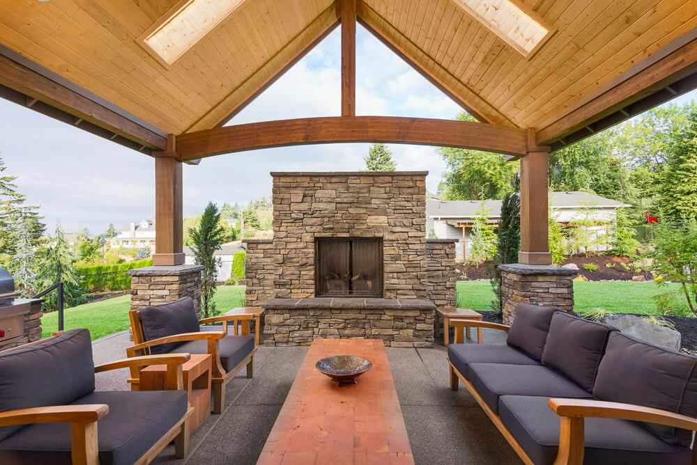 Wide covered patio with outdoor fireplace