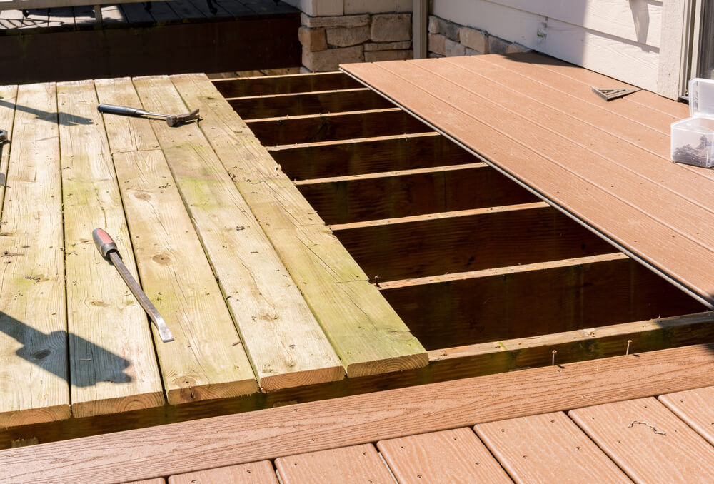Replacing old wood on deck with composite deck materials