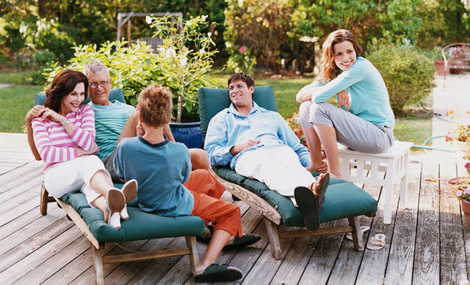 Family sitting on deck together