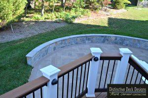 Retaining Wall Defines Patio - Distinctive Deck Designs