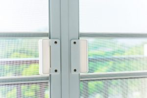 screen doors on a porch or deck to keep bugs out