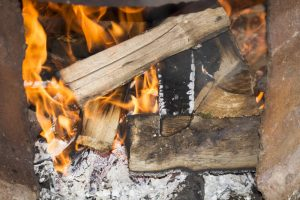 dry wood to burn in backyard fire pit or fireplace