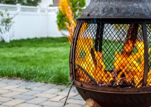 metal firepit or chiminea with an active flame
