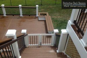 baby gate on deck by Distinctive Deck Designs