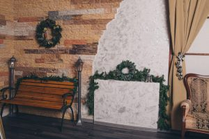 porch decorated with Christmas garlands