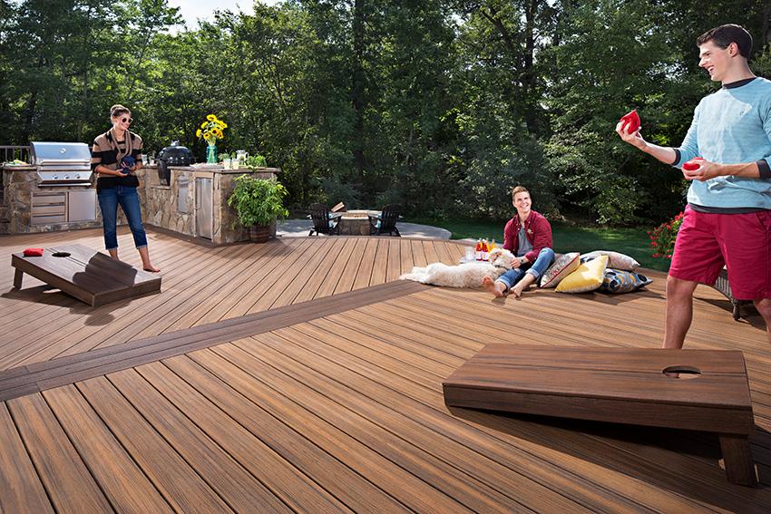 people enjoying game of cornhole on Trex® deck