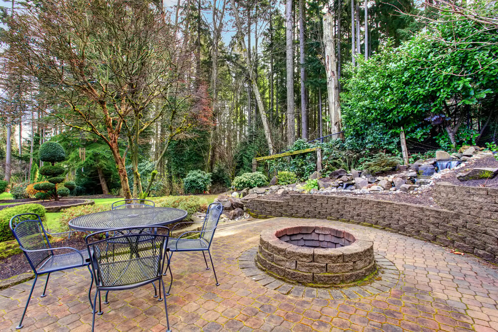 fire pit embedded in paver patio by builders