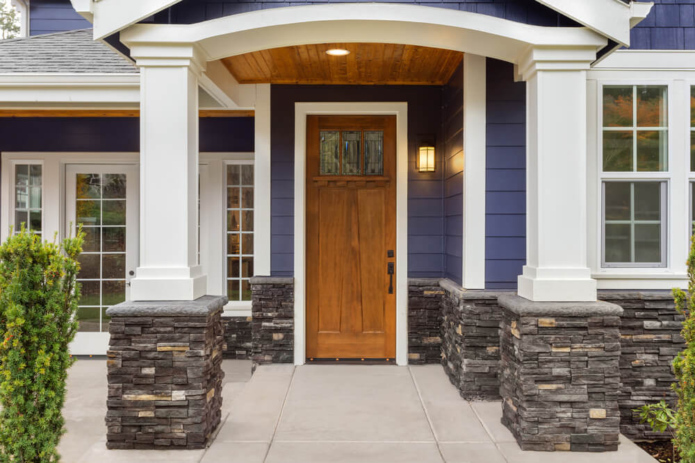 Stone Veneer Added To White Portico Porch Posts