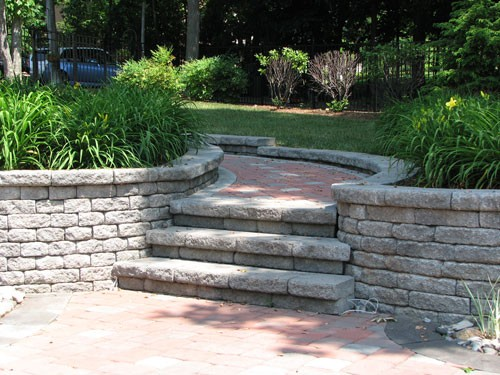 Outdoor stairs made of stone pavers leading to patio in Virginia
