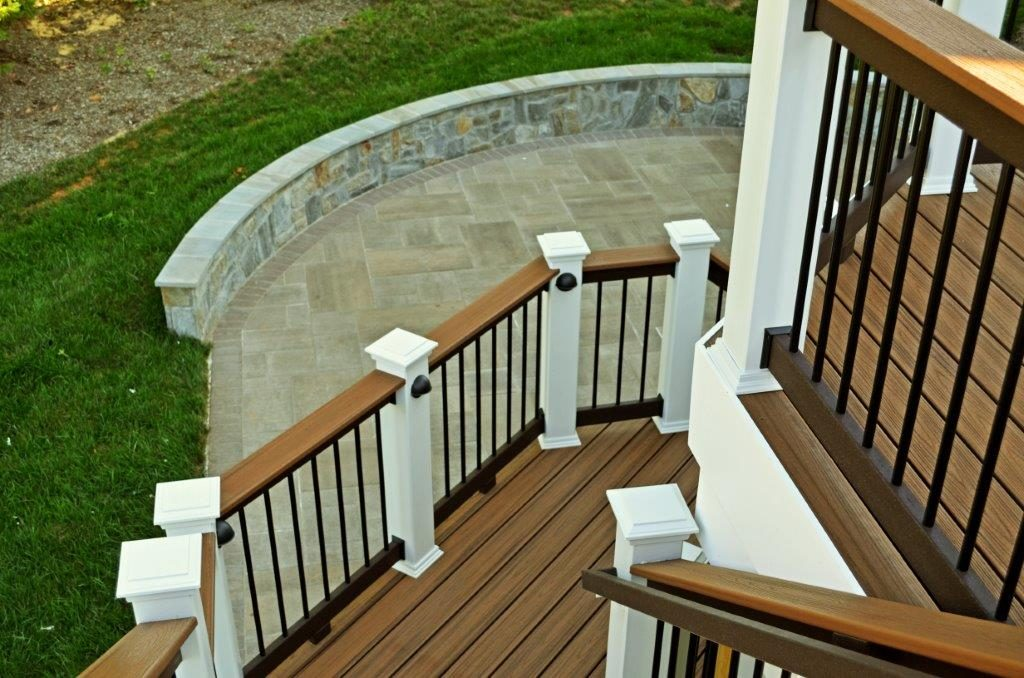 Modern deck design with stairs leading to stone patio