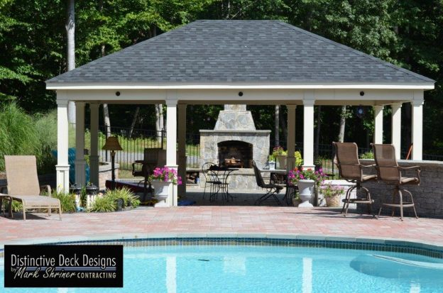 Custom covered patio design by a pool in Northern Virginia
