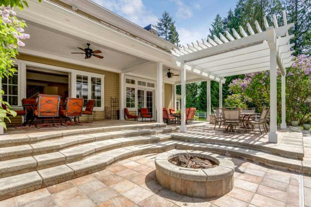 A deck with bright orange accents and a fire pit.