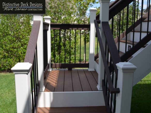 A close of up Trex decking on a white staircase.