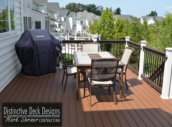 A Virginia backyard with a spacious deck and a table set.