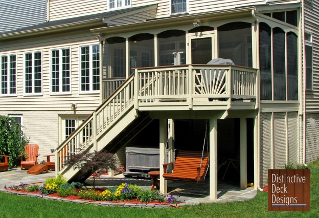 Distinctive Deck Designs two-story deck with a bench swing.